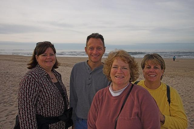 Jeaneanne, Scott, Lesley, and Sue at the North Sea near Bamburgh.