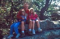 Scott, Lindsey, and Haley pose on a rock on top of Lookout Mountain