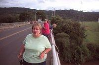 Sue and Lesley try to get photos of the crocodiles down below.  It looks like Sharon, in the background, might be yelling at the