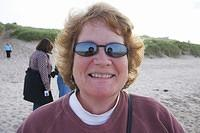 Lesley enjoying a walk on the beach at the North Sea.