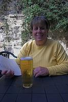 Sue enjoys a glass of Stella at an Alnwich pub.